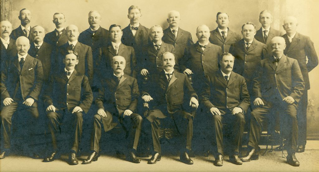In this 1913 Maine House of Representatives photograph, Edwin F. Yeaton is 2nd from left in the back row.